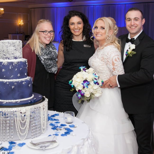 Bride and groom with cake, Falls Manor