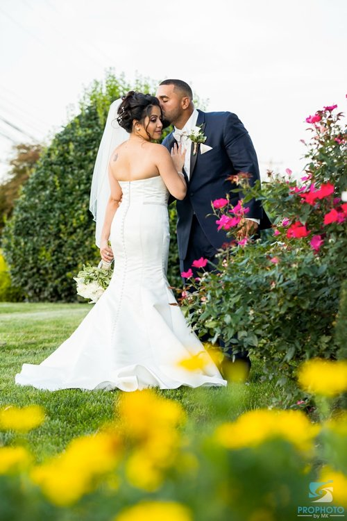 Bride and groom in field, Falls Manor